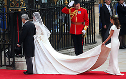 File photo dated 29/04/11 of Kate Middleton arriving at Westminster Abbey, London, with her father Michael and sister Pippa, before her marriage to Prince William. The Duchess of Cambridge will have spent a decade as an HRH when she and the Duke of Cambridge mark their 10th wedding anniversary on Thursday. Issue date: Wednesday April 28, 2021.