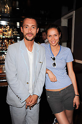 VISCOUNT MACMILLAN and SASHA VOLKOVA at a party to celebrate the publication of The Shape of Her by Rowan Somerville held at Quo Vadis, 26 Dean Street, London on 22nd June 2010.