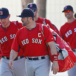 February 18, 2011; Fort Myers, FL, USA; Boston Red Sox catcher Jason Varitek (center) leads the catchers to practice during spring training at the Player Development Complex.  Mandatory Credit: Derick E. Hingle