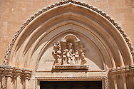The Italian Gothic medieval relief sculptures of the Madonna & Child over the main door of the Cathedral of Ostuni built between 1569-1495  .Ostuni, The White Town, Puglia, Italy. .<br /> <br /> Visit our ITALY HISTORIC PLACES PHOTO COLLECTION for more   photos of Italy to download or buy as prints https://funkystock.photoshelter.com/gallery-collection/2b-Pictures-Images-of-Italy-Photos-of-Italian-Historic-Landmark-Sites/C0000qxA2zGFjd_k<br /> .<br /> <br /> Visit our MEDIEVAL PHOTO COLLECTIONS for more   photos  to download or buy as prints https://funkystock.photoshelter.com/gallery-collection/Medieval-Middle-Ages-Historic-Places-Arcaeological-Sites-Pictures-Images-of/C0000B5ZA54_WD0s