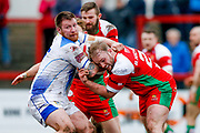 Workington Town interchange Andrew Dawson (16) is tackles by Keighley Cougars interchange Brad Nicholson (29)  during the Betfred League 1 match between Keighley Cougars and Workington Town at Cougar Park, Keighley, United Kingdom on 18 February 2018. Picture by Simon Davies.