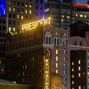 Hilton Hotel President in downtown Kansas City, Missouri at dusk, 2021. This viewing angle from Truman and Grand Avenue will soon be obscured by the up-and-coming Three Light Tower construction.