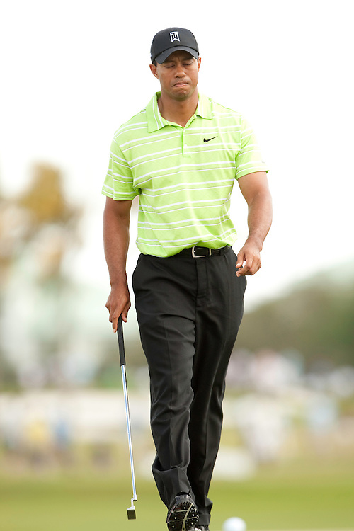 DORAL, FL - MARCH 14:  Tiger Woods reacts to his putt during the third round of the 2009 WGC-CA Championship at Doral Golf Resort and Spa in Doral, Florida on Saturday, March 14, 2009. (Photograph by Darren Carroll) *** Local Caption *** Tiger Woods