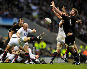 Twickenham, GREAT BRITAIN, Tom DONNELLY and Adam THOMPSON attempt to charge down Paul HODGON's clearence kick, during the Investic Challenge Series, England vs New Zealand, Autumn International at Twickenham Stadium, Surrey on Saturday  21/11/2009   [Photo, Peter Spurrier/Intersport-images]