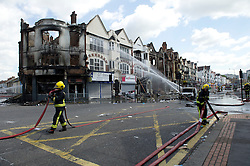 © Licensed to London News Pictures. 09/08/2011. London, UK. A fireman at the corner of St. James Road and London Road, a site badly burnt in the fires caused by rioting in Croydon, London. Photo credit : Mary Stamm-Clarke/LNP