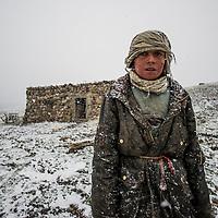 Askarkhan, 13 years old in the summer grazing pastures, Karabel camp, 4200m, Wakhan corridor, Afghanistan.