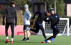 England's Jadon Sancho (right) and Ruben Loftus-Cheek (second right) during the training session at Enfield Training Ground, London.