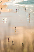 High angle view of people relaxing on beach, Conil de la Frontera, Spain