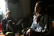 Mirela, 26, (right) from Romania, is worried about the eviction notice received the day before, for the Ingram Avenue mansion, while George, 26, is having a smoke sitting on the back of the room, on Saturday, Oct. 6, 2007, in Hampstead, London, England. The squatters will have to face Court and possibly face eviction within the next two of weeks. The 22-room mansion was last sold for UK£ 3.9M in 2002 and is now awaiting planning permissions to be demolished. Two new houses will soon be taking its place. Million Dollar Squatters is a documentary project in the lives of a peculiar group of squatters residing in three multi-million mansions in one of the classiest residential neighbourhoods of London, Hampstead Garden. The squatters' enthusiasm, their constant efforts to look after what has become their home, their ingenuity and adventurous spirit have all inspired me throughout the days and nights spent at their side. Between the fantasy world of exclusive Britain and the reality of squatting in London, I have been a witness to their unique story. While more than 100.000 properties in London still lay empty to this day, squatting provides a valid, and lawful alternative to paying Europe's most expensive rent prices, as well as offering the challenge of an adventurous lifestyle in the capital.