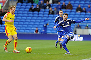 Cardiff City's Scott Malone (r) passes past Rotherham and former Cardiff City favourite Chris Burke. Skybet football league championship match, Cardiff city v Rotherham Utd at the Cardiff city stadium in Cardiff, South Wales on Saturday 23rd January 2016.<br /> pic by Carl Robertson, Andrew Orchard sports photography.