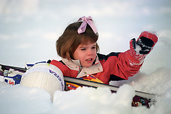File photo dated 04/01/1995 of Princess Eugenie of York sitting in the snow during a skiing trip with her parents, sister and cousins in the Swiss resort of Klosters. Buckingham Palace has announced that Princess Eugenie has become engaged to Jack Brooksbank.