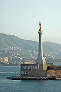 The Virgin Mary statue at the entrance to the port of Messina, Straits of Messina, stretto di Messina between the island of Sicily and main land Italy, July 2006