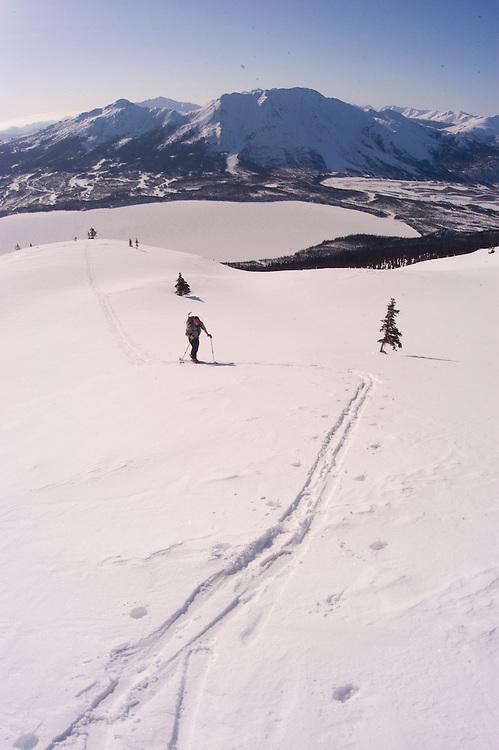 Brooks Range. Iniakuk Lake Lodge. Backcountry Skiing. Philip Peterson skins up a peak in the Brooks Range at Iniakuk Lake Lodge. Backcountry Teleskiing.