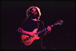 Jerry Garcia performing with the Grateful Dead in Concert at the Huntington Civic Center, Huntington West Virginia on 16 April 1978. Image No. 78C16-15
