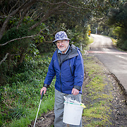 John collecting rubbish
