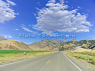 Taken while crossing Northen Montana at 80 miles-per-hour from a Harley-Davidson motorcycle.  The cloud POPS out of the picture.  It's pretty cool, actually.