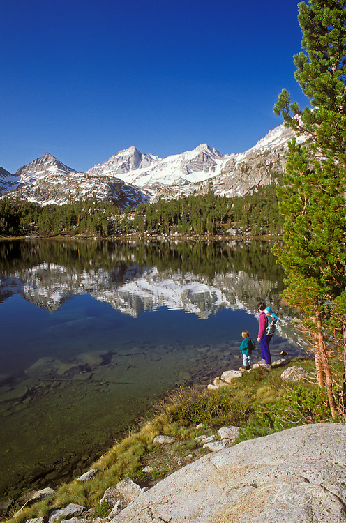 Mother and kids on the shore of Long Lake, John Muir Wilderness, Sierra Nevada Mountains, California