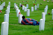 Grieving at Fort Snelling Military Cemetery on Memorial Day age 35.  Minneapolis Minnesota USA