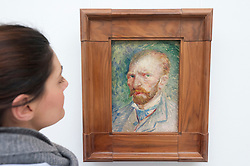 Woman looking at painting Self Portrait by Vincent van Gogh at Kroller-Muller Museum in The Netherlands