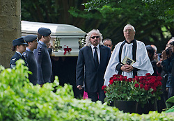 © London News Pictures. 08/06/2012. Thame, UK.  Barry Gibb, brother of Robin Gibb leading the coffin from St Mary's Church in Thame, Oxfordshire following the funeral of Robin Gibb on June 8, 2012. Robin Gibb died on May 20, 2012 aged 62 following a long battle against cancer. Photo credit: Ben Cawthra/LNP