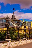 Pont Alexandre III (bridge) across the Seine River. The bridge is the most ornate in the city. The Grand Palais is in the background. Paris, France.