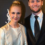 NLD/Amsterdam//20140324 - Filmpremière Yves Saint Laurent, Kimberly Klaver en partner Bas Schothorst