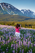 Visitor taking a photo with an ipad, Chugach National Forest, Alaska.  (model released)