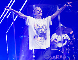 © Licensed to London News Pictures. 30/08/2015. Reading, UK. Years and Years performing at Reading Festival 2015, Day 3 Sunday.  In this picture -  Olly Alexander.  Photo credit: Richard Isaac/LNP