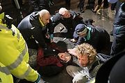 April, 18th, 2019 - London, Greater London, United Kingdom: Police arrest protesters. Westminster Parliament Square Demonstration against Climate Crisis. Extinction Rebellion is demanding the UK government takes urgent action on climate change and wildlife declines. Extinction Rebellion activists disrupt traffic around famous London Landmarks. Thousands of protesters  converging on central hubs including Oxford Circus and Parliament Square. Nigel Dickinson/Polaris