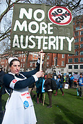 Tens of thousands of health workers, activists and members of the public protested against austerity and cuts in the NHS National Health Service on March 4th 2017 in London, United Kingdom. A woman dressed as Florence Nightingale holds a placard saying No more austerity
