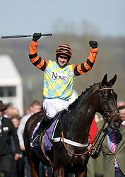 Nico de Boinville celebrates winning the RSA Novices' Chase on Might Bite during Ladies Day of the 2017 Cheltenham Festival at Cheltenham Racecourse