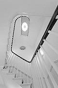 looking up at white spiral staircase in a london residential property.