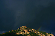 """SHOT 7/16/2006 - Sunset and a rainbow in Crested Butte, Co. The historic Town of Crested Butte is a Home Rule Municipality located in Gunnison County, Colorado, United States. A former coal mining town now called """"the last great Colorado ski town"""", Crested Butte is a destination for skiing, mountain biking, and a variety of other outdoor activities.The Colorado General Assembly has designated Crested Butte the wildflower capital of Colorado..(Photo by MARC PISCOTTY / © 2006)"""