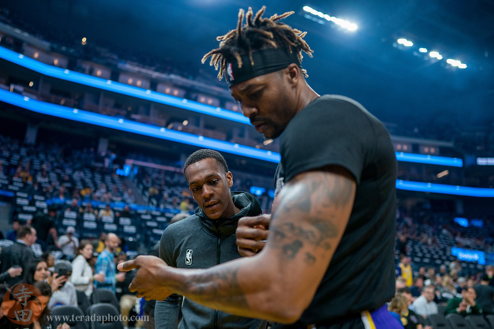 February 27, 2020; San Francisco, California, USA; Los Angeles Lakers guard Rajon Rondo (9, left) and center Dwight Howard (39, right) doing a pre-game routine before the game against the Golden State Warriors at Chase Center.