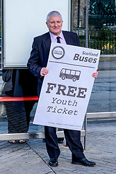 Scottish Greens, Free Bus Travel, 27 February<br /> <br /> Ahead of the budget debate this afternoon, Scottish Greens Parliamentary Co-Leaders Alison Johnstone MSP and Patrick Harvie MSP along with the Green MSP group staged a photocall outside the Scottish Parliament to celebrate their free bus travel for under 19s budget win.<br /> <br /> The Scottish Greens yesterday announced that a deal had been struck on free bus travel, more money for councils, extra resource for community safety and an additional £45 million package to tackle fuel poverty and the climate emergency.<br /> <br /> Pictured:  John Finnie MSP<br /> <br /> Alex Todd | Edinburgh Elite media