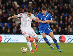 Sam Vokes of Wales (Burnley) holds the ball up from Kari Arnson (Rotherham United) of Iceland - Photo mandatory by-line: Dougie Allward/JMP - Tel: Mobile: 07966 386802 03/03/2014 -