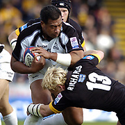 Wycombe. GREAT BRITAIN, 10th October 2004, Guinness Premiership Rugby, London Wasps and Newcastle Falcons, Adams Park, ENGLAND. [Mandatory Credit; Pete Spurrier/Intersport-images]<br /> <br /> Falcons's Epi Taione tackled by Wasps peter Richards