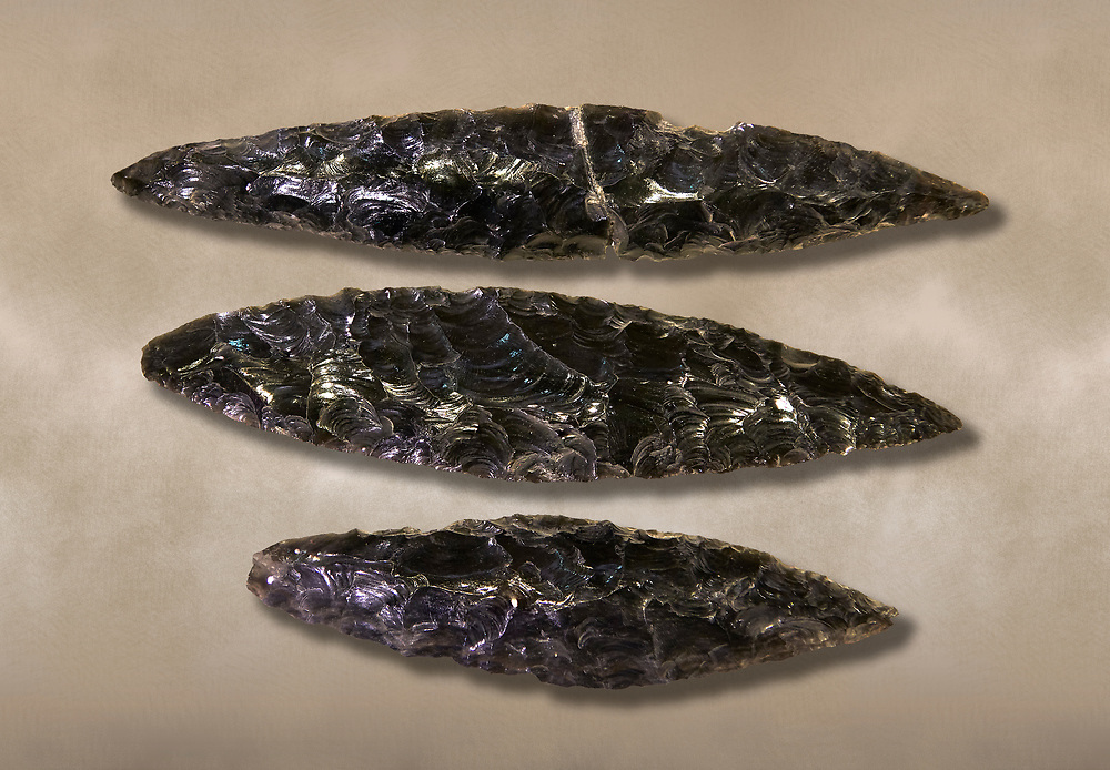 Black obsidian blades. Catalhoyuk Collections. Museum of Anatolian Civilisations, Ankara .<br /> <br /> If you prefer you can also buy from our ALAMY PHOTO LIBRARY  Collection visit : https://www.alamy.com/portfolio/paul-williams-funkystock/prehistoric-neolithic-art.html - Type Catalhoyuk into the LOWER SEARCH WITHIN GALLERY box. Refine search by adding background colour, place, museum etc.<br /> <br /> Visit our PREHISTORIC PLACES PHOTO COLLECTIONS for more  photos to download or buy as prints https://funkystock.photoshelter.com/gallery-collection/Prehistoric-Neolithic-Sites-Art-Artefacts-Pictures-Photos/C0000tfxw63zrUT4