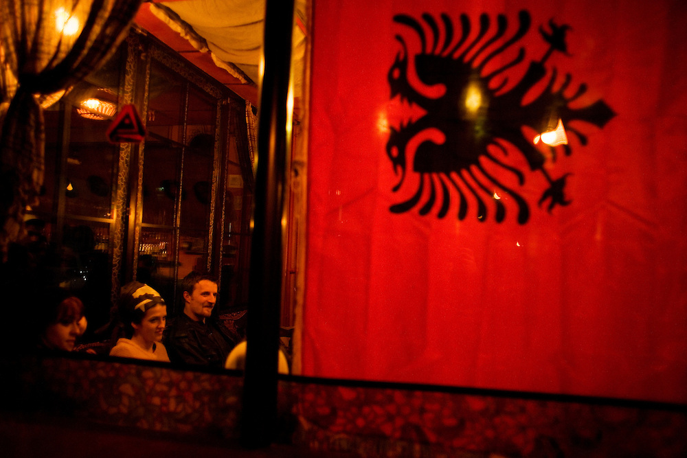 Kosovars celebrate the one-year anniversary of independence along Mother Theresa Street in the center of the capitol, Prishtina. Bar with young people...Prishtina, Kosovo - One-year anniverary of Independence - February 17, 2009.