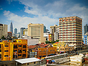 05 JUNE 2015 - KUALA LUMPUR, MALAYSIA:  The skyline of Kuala Lumpur, Malaysia. This is looking east into the Chinatown area from the Pasar Seni lightrail station.    PHOTO BY JACK KURTZ