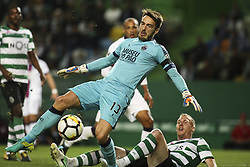 October 22, 2017 - Lisbon, Portugal - Sporting's midfielder Matieu (R)  vies with Chaves's goalkeeper Ricardo during the Portuguese League  football match between Sporting CP and Chaves at Jose Alvalade  Stadium in Lisbon on October 22, 2017. (Credit Image: © Carlos Costa/NurPhoto via ZUMA Press)