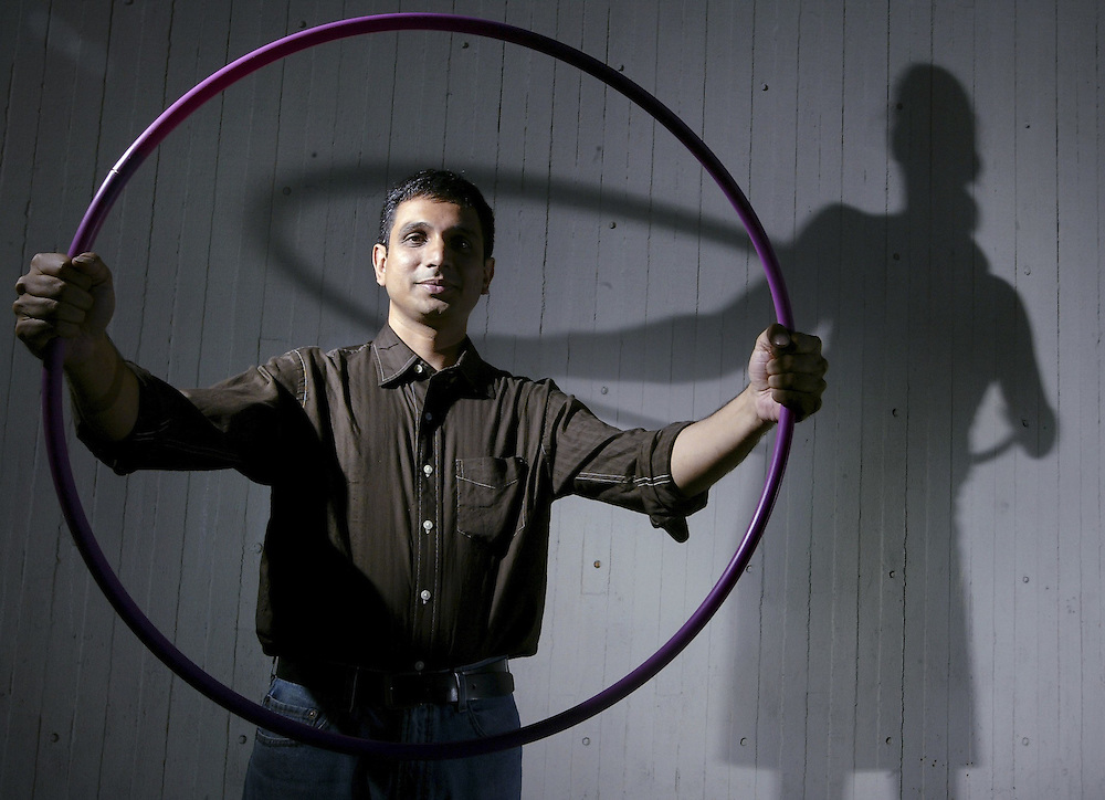 Ramesh Balasubramaniam is a professor at the University of Ottawa that specializes in human kinetics and has done a research project focusing on the body's timing and movement when using a hulahoop. He pictured on the universtiy grounds in Ottawa on July 20, 2005.  .(Ottawa Sun Photo By Sean Kilpatrick)