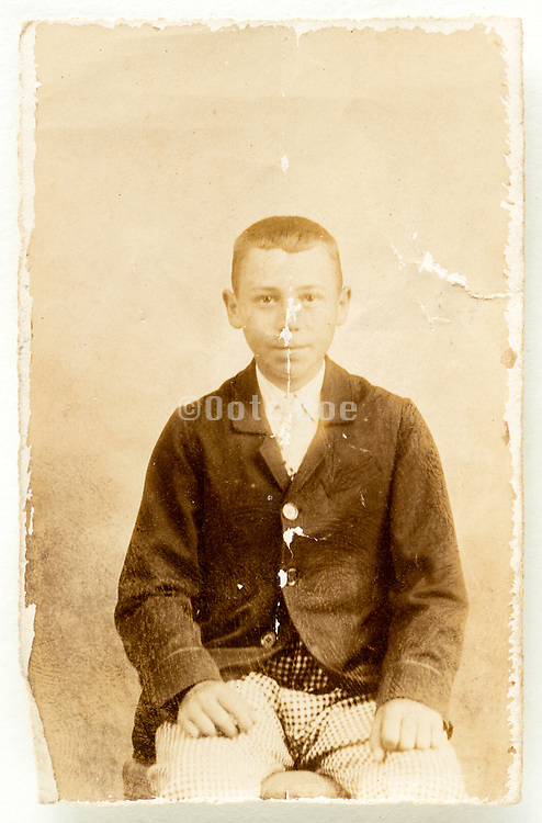 boy posing for a studio portrait circa 1920s