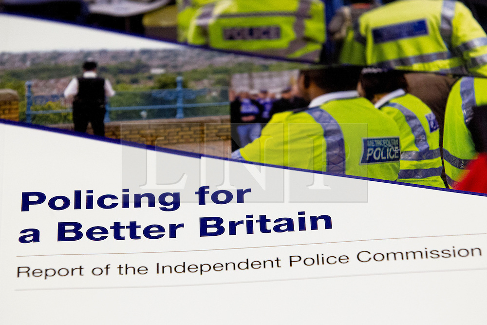 © Licensed to London News Pictures. 25/11/2013. London, UK. A copy of the report prepared by the Independent Commission on the future of Policing in England and Wales, at the Royal Society of Arts in London today (25/11/2013). Photo credit: Matt Cetti-Roberts/LNP