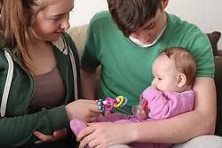 Teenage couple with baby