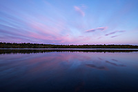 Sunset reflection on lake Tjeggelvas from middle section of Kungsleden Trail, Lapland, Sweden