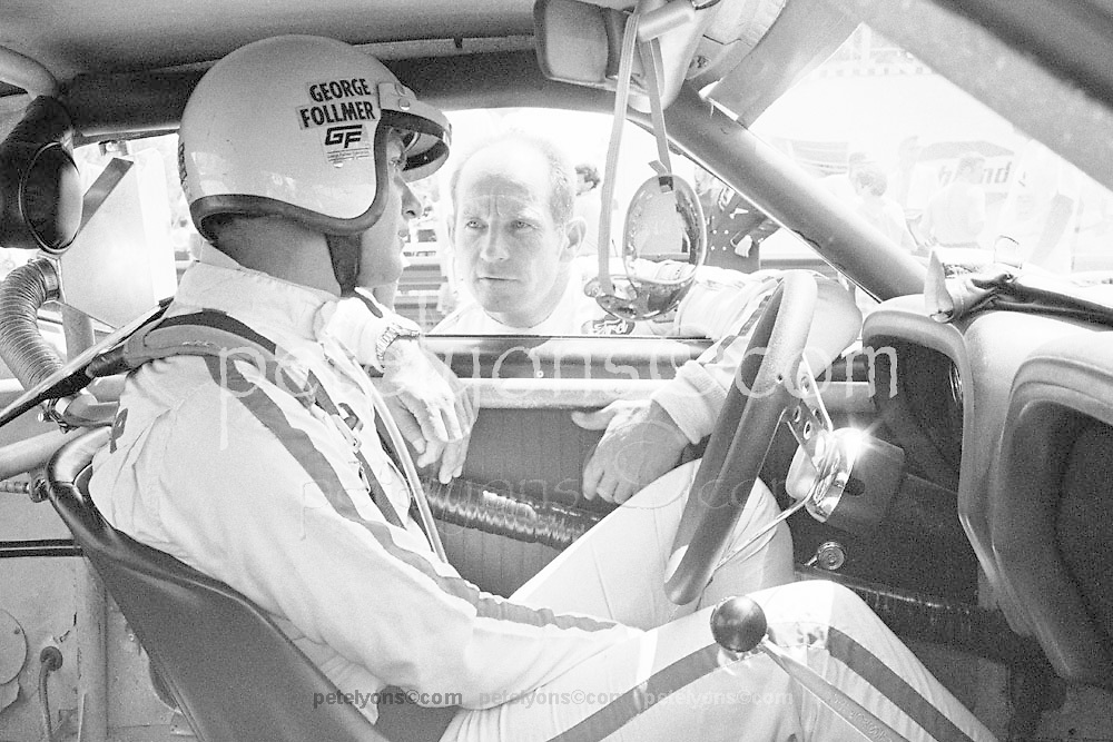 George Follmer and Ford Mustang team mate Parnelli Jones confer on starting grid for 1970 Trans-Am race at Mid-Ohio; PHOTO BY Pete Lyons 1970 / www.petelyons.com