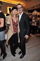 MARYAM D'ABO and BRUNO FRISONI at a party to celebrate the arrival of the 'A Princess to be a Queen' collection at the Roger Vivier boutique on Sloane Street, London on 20th October 2009.