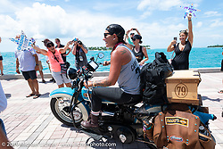 Jody Perewitz crosses the finish line on her 1936 Harley-Davidson VLH at the end of the Cross Country Chase motorcycle endurance run from Sault Sainte Marie, MI to Key West, FL. (for vintage bikes from 1930-1948). The Grand Finish in Key West's Mallory Square after the 110 mile Stage-10 ride from Miami to Key West, FL and after covering 2,368 miles of the Cross Country Chase. Sunday, September 15, 2019. Photography ©2019 Michael Lichter.