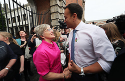 An Taoiseach Leo Varadkar greets Minster for Children Katherine Zappone as he arrives at Dublin Castle for the results of the referendum on the 8th Amendment of the Irish Constitution which prohibits abortions unless a mother's life is in danger. Picture date: Saturday May 26, 2018. See PA story IRISH Abortion. Photo credit should read: Brian Lawless/PA Wire